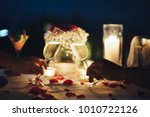 romantic candlelight dinner... | Shutterstock . vector #1010722126