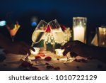 romantic candlelight dinner... | Shutterstock . vector #1010722129