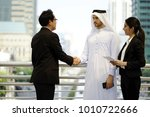 arab businessman are shaking... | Shutterstock . vector #1010722666