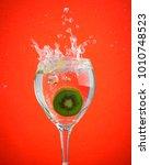 fruit splash in wine glass... | Shutterstock . vector #1010748523