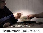the drug dealer is selling... | Shutterstock . vector #1010750014
