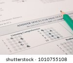 Small photo of Close-up photograph of a perfect grade on a scantron test.