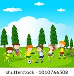 boys playing soccer in park... | Shutterstock .eps vector #1010766508