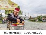 unidentified man sells ottoman... | Shutterstock . vector #1010786290