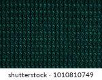 green fabric texture background.... | Shutterstock . vector #1010810749
