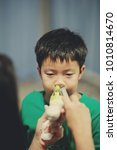 Small photo of children Nasal wash. boy feel sick. cleaning nose. healthcare concept