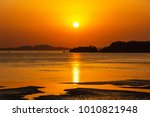 beautiful sunset above the sea. ... | Shutterstock . vector #1010821948