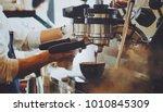 barista make coffee latte art... | Shutterstock . vector #1010845309