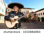mexican musician mariachi with... | Shutterstock . vector #1010886883