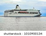 white cruise liner sailing on a ... | Shutterstock . vector #1010900134