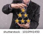 quality concept between hands... | Shutterstock . vector #1010941450