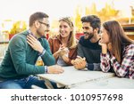 group of four friends having... | Shutterstock . vector #1010957698