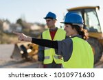 couple of workers looking for... | Shutterstock . vector #1010971630