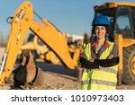 posing woman looking at camera... | Shutterstock . vector #1010973403