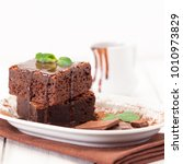 chocolate brownie square pieces ...   Shutterstock . vector #1010973829