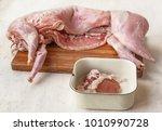 raw rabbit carcass on the... | Shutterstock . vector #1010990728