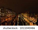 night city in motion of light... | Shutterstock . vector #1011040486