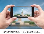 traveler holding smartphone to...   Shutterstock . vector #1011052168
