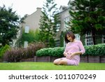 pregnant woman sitting and... | Shutterstock . vector #1011070249