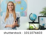 young female travel agent... | Shutterstock . vector #1011076603
