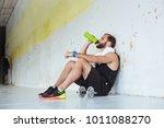 fit man taking a break from... | Shutterstock . vector #1011088270