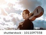 drifter with a guitar | Shutterstock . vector #1011097558