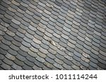 old tiled roof. top of building.... | Shutterstock . vector #1011114244