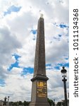 Small photo of Close up view of the Obelisk at Place de la Concord. Paris France. Cloudy sky background