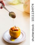 baked apple drizzled with honey....   Shutterstock . vector #1011134974