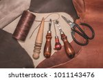 tools for leather crafting and... | Shutterstock . vector #1011143476