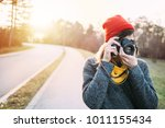 girl with retro camera. hipster ...   Shutterstock . vector #1011155434