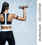 strong woman working out with... | Shutterstock . vector #1011157018