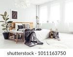 white spacious bedroom interior ... | Shutterstock . vector #1011163750