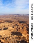 Small photo of Stony desert panoramic view. Unique relief geological erosion land form. National park HaMakhtesh HaGadol - Large Crater. Negev, Israel