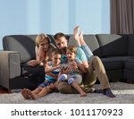 happy young family playing... | Shutterstock . vector #1011170923