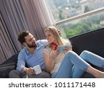young couple relaxing at  home... | Shutterstock . vector #1011171448