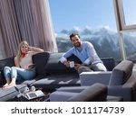 young couple relaxing at  home... | Shutterstock . vector #1011174739