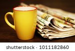 stack of newspapers and cup of... | Shutterstock . vector #1011182860