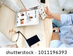 people in the office watching... | Shutterstock . vector #1011196393