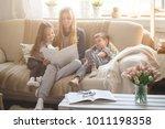 happy family reading books... | Shutterstock . vector #1011198358