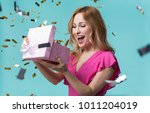 what is inside. curious young... | Shutterstock . vector #1011204019