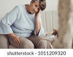 worried elderly woman with a... | Shutterstock . vector #1011209320