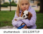 7 year old girl is walking with ... | Shutterstock . vector #1011209719