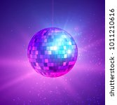 disco ball with bright rays.... | Shutterstock .eps vector #1011210616