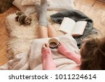 coziness at home  girl hygge... | Shutterstock . vector #1011224614