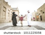 arabic family playing with child | Shutterstock . vector #1011225058
