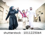 arabic family playing with child | Shutterstock . vector #1011225064
