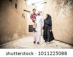 arabic family playing with child | Shutterstock . vector #1011225088