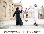 arabic family playing with child | Shutterstock . vector #1011225094