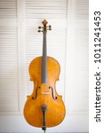 Cello On White Wooden Background
